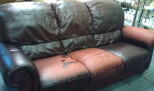 APC Damaged Leather Sofa